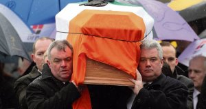 Detective Garda Joe Ryan, right, who witnessed the murder, helps carry the coffin during the state funeral of Detective Garda Adrian Donohoe in Dundalk.