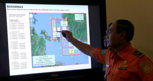 A member of Indonesian National Search and Rescue Agency (BASARNAS) shows a map of the search area.Picture: AP