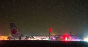 Air Canada flight 624 rests off the runway after landing at Stanfield International Airport in Halifax, Canada, today. Pic: AP