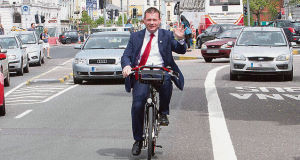 Minister Alan Kelly takes to the saddle outside Cork's City Hall to launch the Coca-Cola Zero Bikes scheme but didn't wear a helmet.