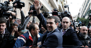 Alexis Tsipras, leader of Greece's Syriza left-wing main opposition waves to his supporters after voting today. Pic: AP