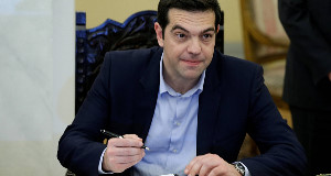 Alexis Tsipras signs a protocol after the swearing in ceremony of his cabinet.