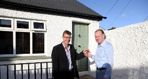 Chief Executive Officer of ALONE, Sean Moynihan, handing over the key to a new home for Brendan. Pic: Jason Clarke Photography