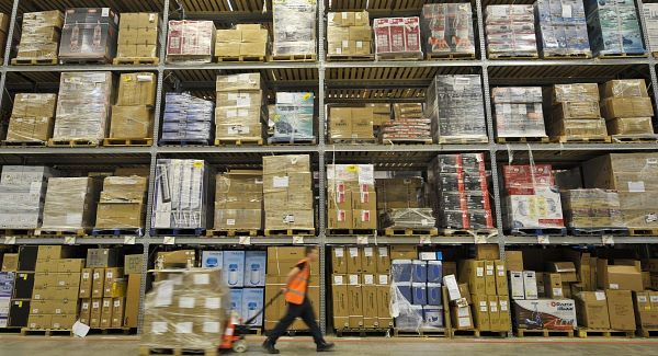 Amazon workers pack goods ready for shipping at an Amazon distribution centre. Picture: PA