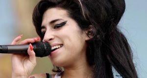 "Winehouse's mother thinks cigarettes and empty alcohol bottles are ""fitting"" tributes to her daughter"