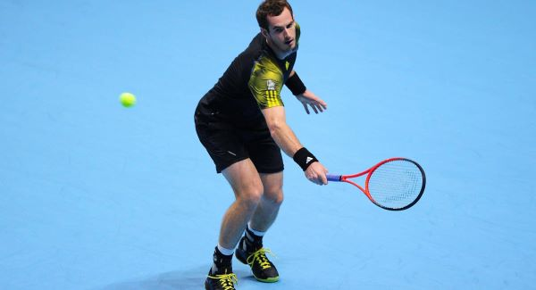 Andy Murray in action against Switzerland's Roger Federer during the Barclays ATP World Tour Finals at the O2 Arena, London