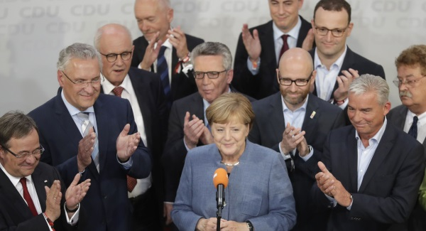 Germany's Angela Merkel seeking 'stable government' in coalition talks