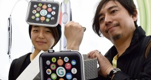 Makoto Saito and Kazumi Oda pose after queuing up to get an Apple Watch at a telecom shop in Tokyoyesterday. Picture: Toshifumi Kitamura/ AFP/Getty Images