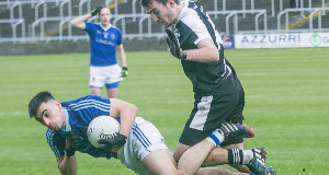 GOING DOWN: Warrenpoint forward Ross McGarry hits the deck after a challenge from Ardfert's David Griffin in yesterday's AIB All-Ireland Club IFC semi-final at O'Moore Park, Portlaoise. Picture: Pat Moore