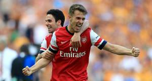 Aaron Ramsey and Mikel Arteta celebrate after the final whistle. Picture: PA