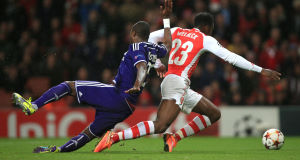 Arsenal's Danny Welbeck (right) is fouled by Anderlecht's Chancel Mbemba to win his side a penalty. Picture: PA