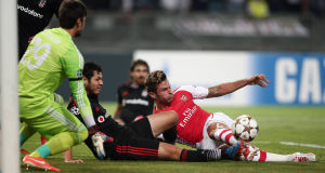 Besiktas's Pedro Franco, center, and Olivier Giroud of Arsenal. Picture: AP