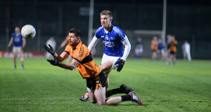Barry Shanahan, Austin Stacks, offloads the ball as he is tackled by Tommy Walsh, Kerins O'Rahillys.