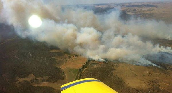 In this photo provided by the New South Wales Rural Fire Service, plumes of smoke rise from a fire near Cooma, Australia today.