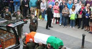 The coffin containing the remains of Albert Reynolds is removed from Mansion House, Dublin