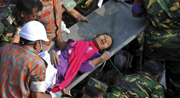 Rescuers carry Reshma Begum, 18, who had been buried for 17 days after the clothing factory collapsed, killing more than 1,000 people. Picture: AP