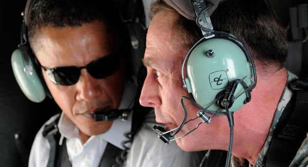 U.S. presidential candidate Barack Obama, left, and top U.S. military commander in Iraq, David Petraeus, talk as they take a helicopter ride