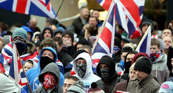 Loyalists protesters in Belfast city centre last month demonstrating against new restrictions on flying the Union flag over City Hall.Picture: PA