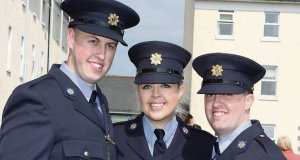 Attending the Garda graduations in Templemore on Thursday were siblings Jennifer Bell with her graduating brothers Joseph and Brian from Lucan. Picture: Liam Burke/Press 22