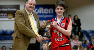 SLAM DUNK: Basketball Ireland Secretary General Bernard O'Byrne presents Saint Mary's College, Galway captain Sean Kelly with the trophy after they won the U-19 B Boys All-Ireland final in Dublin. Picture: Inpho/Donall Farmer