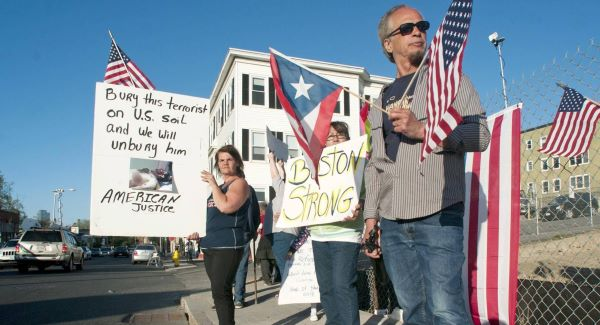Protesters stand outside the funeral home in Worcester, Mass. Picture: AP