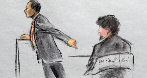 Assistant US Attorney Aloke Chakravarty is depicted pointing to defendant Dzhokhar Tsarnaev, right, during closing arguments.