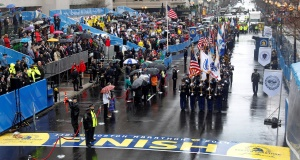 Participants in a memorial service at the finish line of the Boston Marathon yesterday. Picture: AP
