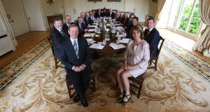 Taoiseach Enda Kenny (front left) and Tanaiste Joan Burton (right) with the new cabinet at Áras an Uachtaráin. Picture: PA