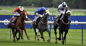 : Captain Cat ridden by George Baker(right) wins the betfred.com Superior Mile. Picture: PA