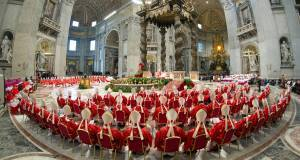 n this photo provided by the Vatican newspaper L'Osservatore Romano, cardinals, in red, attend a Mass for the election of a new pope celebrated by Cardinal Angelo Sodano inside St. Peter's Basilica.