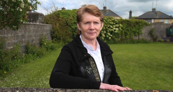 Local historian Catherine Corless at the site of the mass grave for children who died in the Tuam mother-and-baby home. Picture: PA
