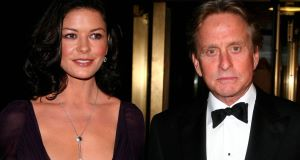 Michael Douglas, pictured with his wife Catherine Zeta-Jones: Linked some throat cancers to oral sex.
