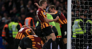 Bradford City's Stephen Darby celebrates after his team-mate Andy Halliday (obscured) scores his side's third goal.