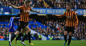 Bradford City's Jonathan Stead (left) celebrates scoring his sides first goal of the game during the FA Cup Fourth Round match at Stamford Bridge, London.