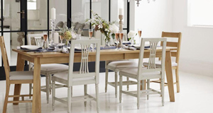 Are you long overdue a new dining table and chairs? Get organised for Christmas dinner with a modern design that echoes 1950's styling (Modus dining table with four chairs €1,429 at DFS)