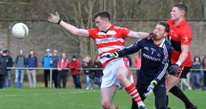 CLOSE CALL: CIT's Stephen Cahill and David Hanrahan try to win possession under pressure  from UCC's Conor Cox in yesterday's Sigerson Cup match at The Mardyke.