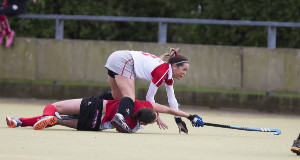 Pegasus' Suzanne Ferris and Harlequins' Cliodhna Sargent tussle for possession during the Ladies Irish Senior Cup quarter-final. Picture: Andy Jay.