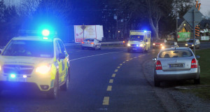 An ambulance is escorted from the scene this evening. Picture: Des Barry