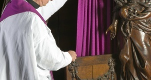 Priest at confession box. Picture: Getty
