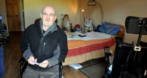 Conor O'Leary in his flat in Bandon, Co Cork, where he lives mostly in one room. A native of the town who worked abroad for many years, Conor now suffers from rheumatoid arthritis and is confined to a wheelchair.