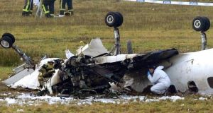 Forensics officers examiner the plane last year.