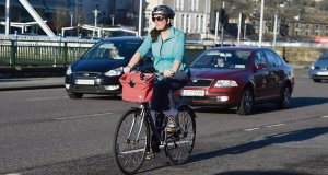 Caroline Delaney cycles nearCork City Hall. Her cycle wasimpeded by potholes,a lackof joined-up cycle lanes,careless drivers and waywardpedestrians.