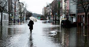 Walking through the flood waters on Cork's South Mall today. Picture: Denis Scannell