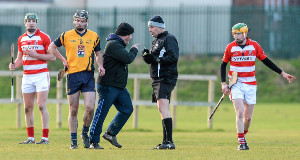 MAKING A POINT: DCU manager Nick Weir remonstrates with referee Brian Gavin during the Fitzgibbon Cup, Group A, first-round game. Below: CIT's John O'Dwyer, who  rattled over eight points for the Cork side.