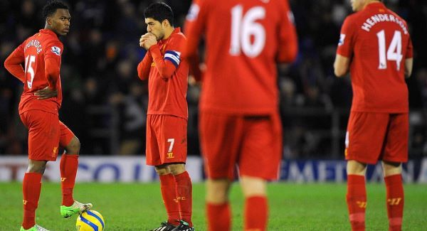 Liverpool's Daniel Sturridge (left) and Luis Suarez (second left) stand dejected after conceding their third goal of the game today. Picture: PA