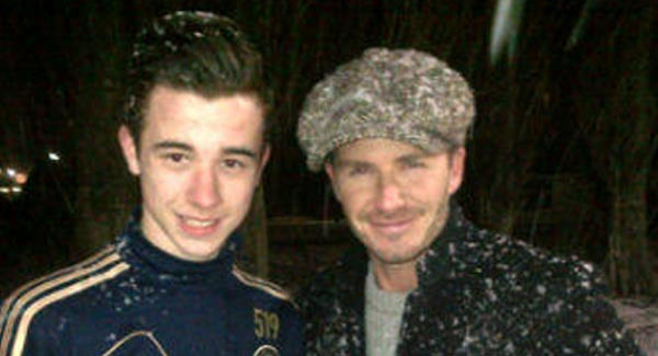 David Beckham pictured with a fan outside Chelsea's Cobham training ground yesterday. Picture via Twitter/@reyondillon