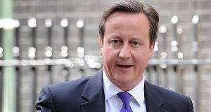 A hoax caller claiming to be director of GCHQ was put through to PM David Cameron