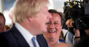 Prime Minister David Cameron laughs as Mayor of London Boris Johnson speaks to staff at Utility Warehouse on May 5, 2015, in Hendon, England.