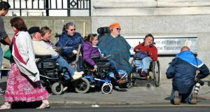 A group of people with disabilities during the protest outside Government Buildings. Picture: PA