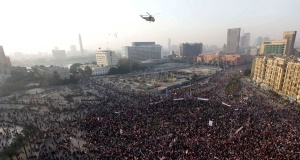 An Egyptian army helicopter flies over Tahrir Square. Picture: AP